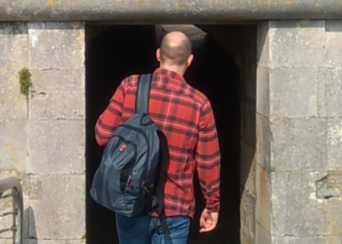 man walking into bunker
