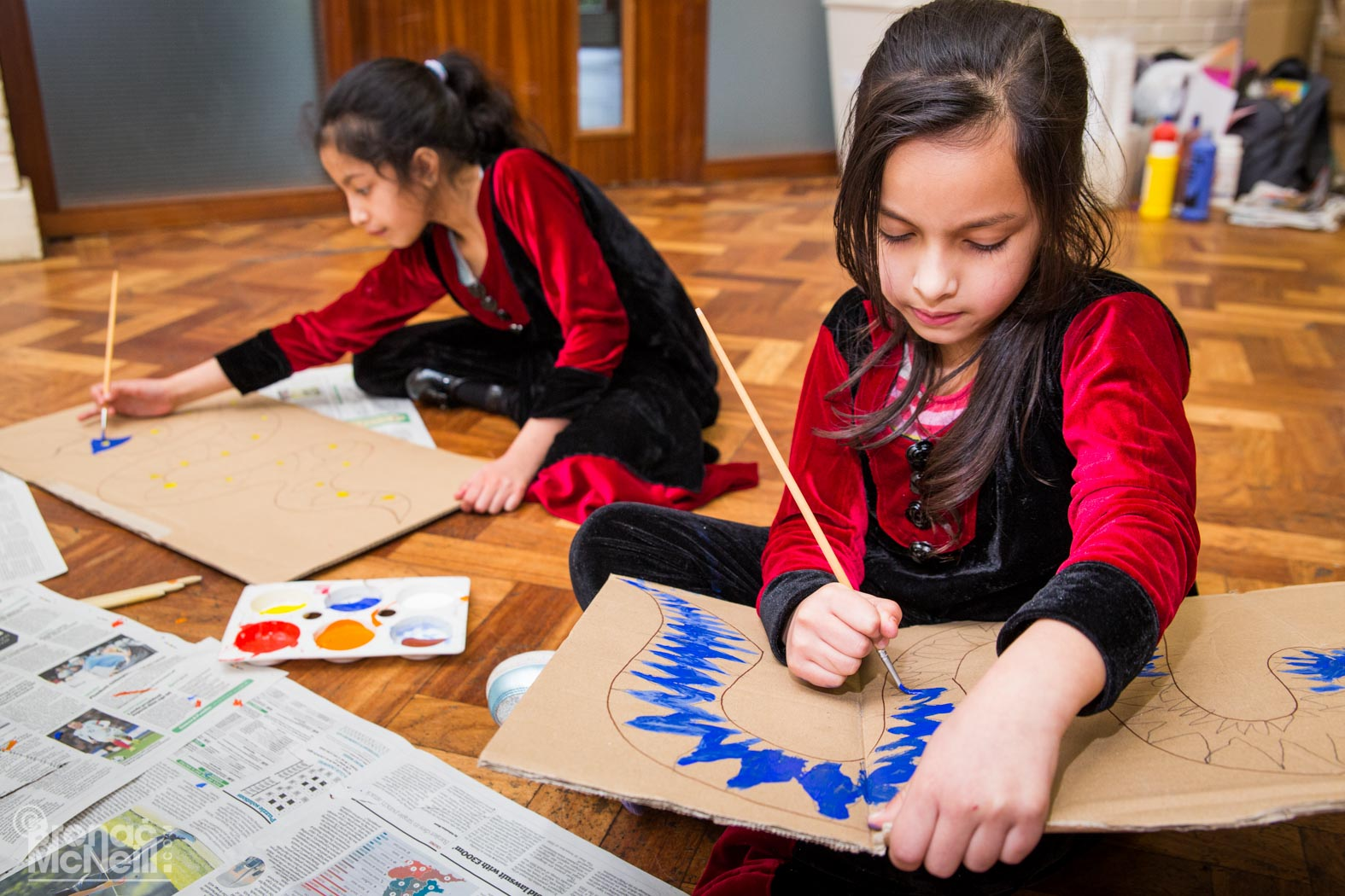 children painting cardboard