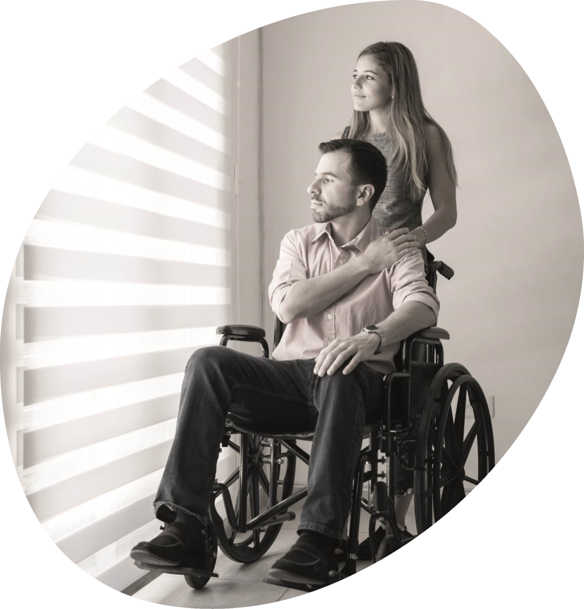 Man in wheelchair with partner