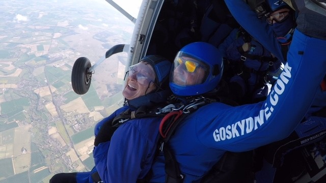 Lesley preparing to jump out the plane with her instructor, Gary.
