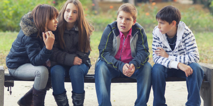 Group of four teenagers on bench